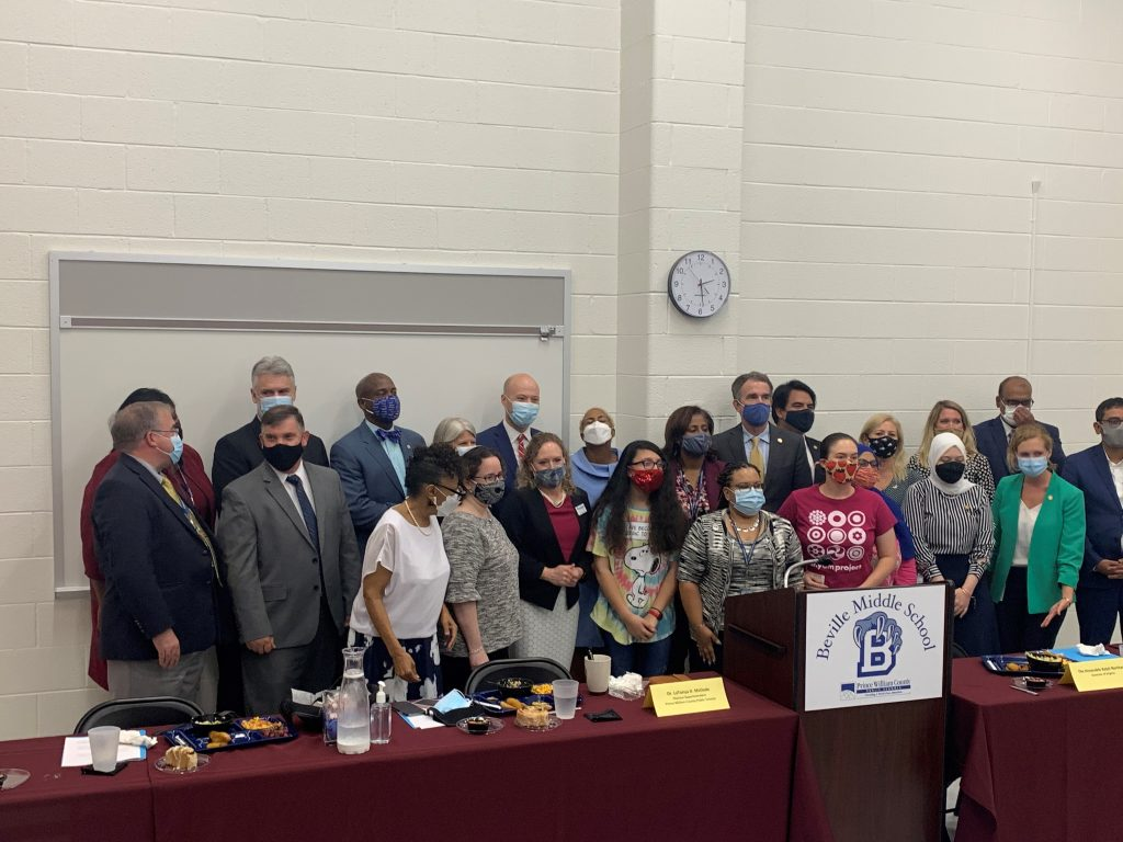 Governor Ralph Northam, Virginia Secretary of Education, Atif Qarni, and several other local and state officials at Beville Middle School
